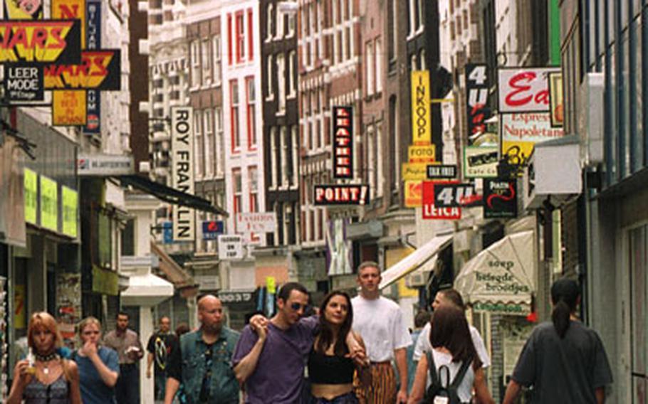 Walking along Kalverstraat, Amsterdam's major pedestrian shopping area.