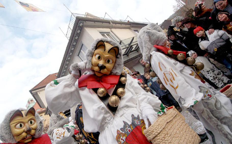 Members of the Katzenzunft (cats guild) from Hardt, Germany, march in the Fasnet parade in Schramberg.
