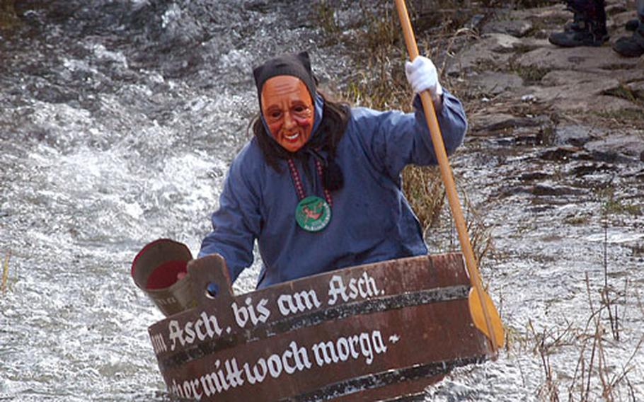 A tub rider traditionally takes the first spin down the river during Schramberg's annual Da-Bach-Na-Fahrt, part of the town's carnival celebrations.