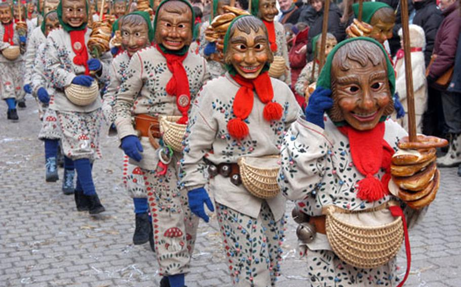 One of many masked Fasnet guilds marches in the Schramberg Fasnet parade.