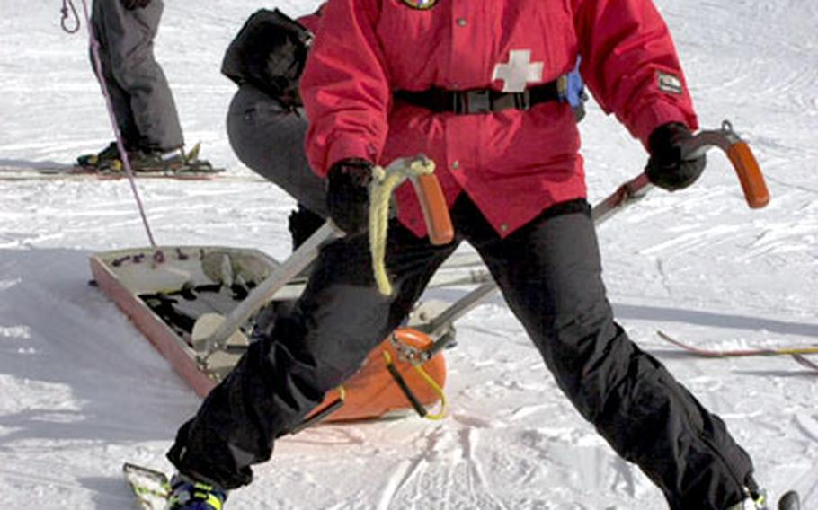 In Hintertux, Austria, patrollers practice in October with a sled used to transport patients. Phyllis Jones grasps the handles and Barry Tiemann holds the tail rope.