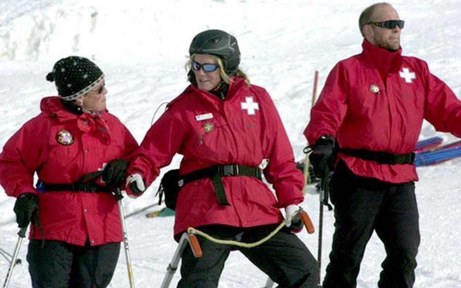 Ski patrol members Phyllis Jones, left, Holly Ginas and Robert Field take a break during training.