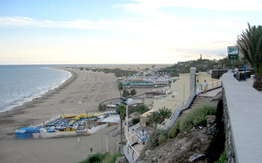 When you're not partying, shopping or on an amusement ride in Maspalomas, Canary Islands, you can rest on the beach. This is a view of the Playa del Ingles, looking toward the southern tip of the island.