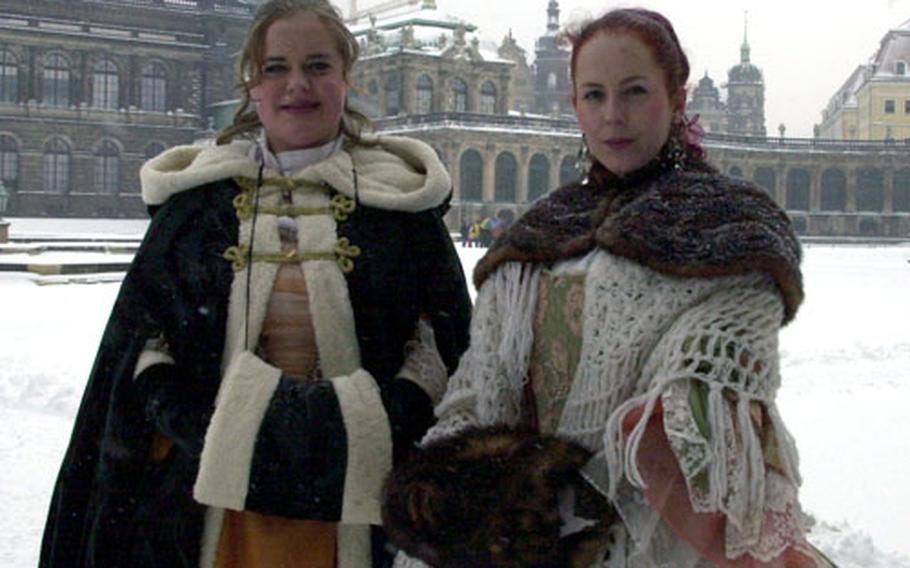 English-speaking tour guides in costume are plentiful in downtown Dresden. The guides are heavily bundled after a recent snowstorm covered much of Germany in a rare blanket of white.