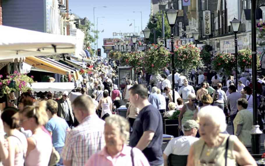 Pedestrians amble through Great Yarmouth's main shopping districts and entertainment areas.