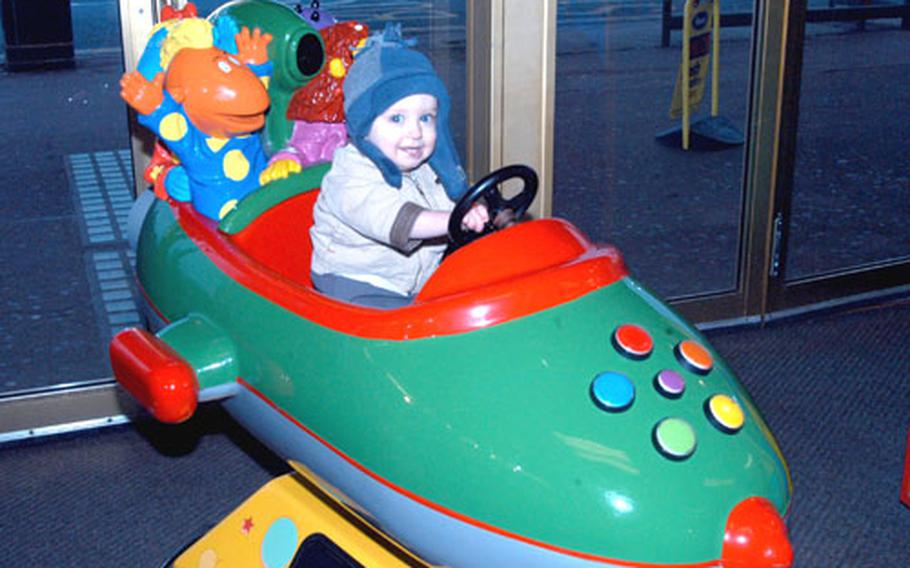 A youngster from RAF Mildenhall enjoys a low-key ride on a rocketship at a Great Yarmouth arcade during the slower winter season. In the spring and summer, expect large crowds.