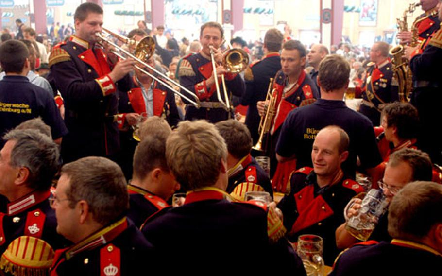 Daytime visitors to an Oktoberfest beer tent could be treated to a performance by one of the bands that roams the festival and strikes up tunes.