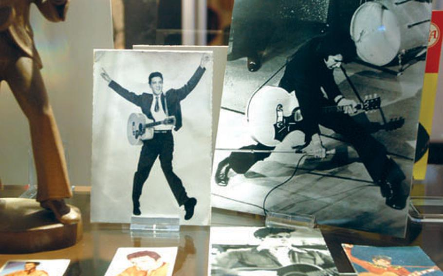 Elvis Presley memorabilia is on display in a special glass cabinet in the Büdinger 50er-Jahre-Museum in Büdingen, Germany.