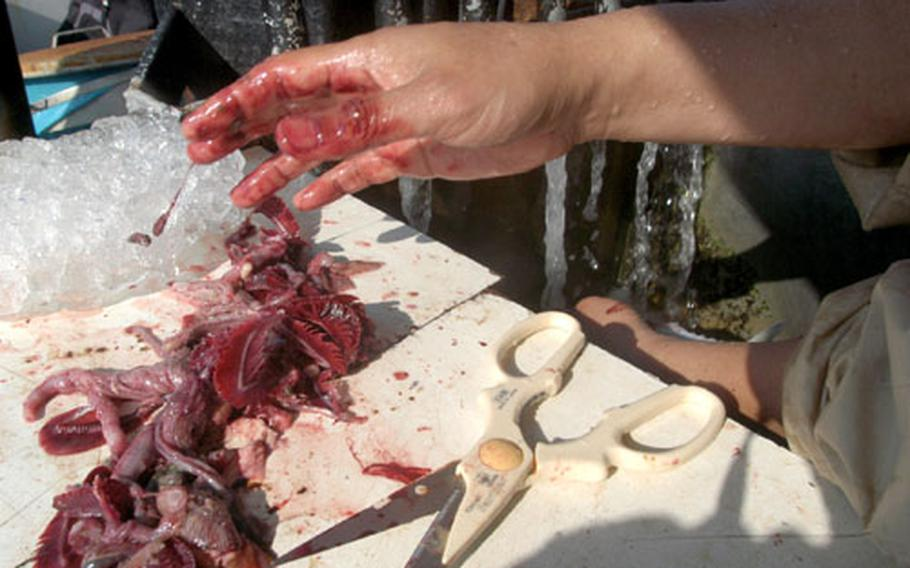 Catching fish is slimy, but gutting them is both slimy and bloody. Anglers can do the job themselves or pay to have a member of the crew gut their catch for them.