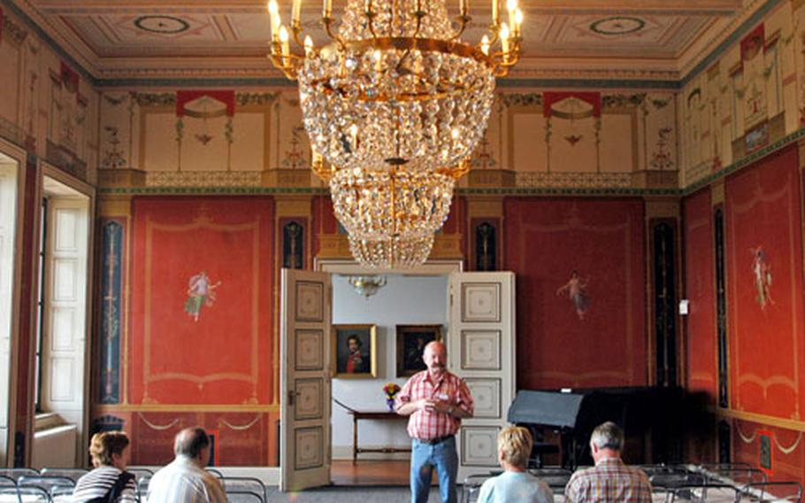 Guide Josef Mootz offers his view of the the Pompeiian Hall, one of the most decorative rooms of the villa.
