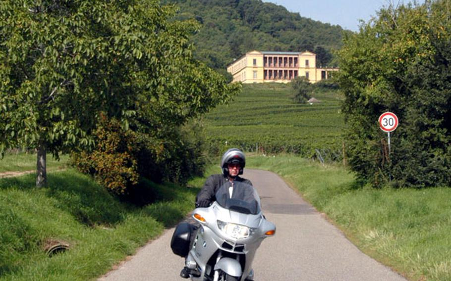 A motorcyclist zips down the road leading from the Villa Ludwigshöhe, which overlooks the vineyards of Rheinland-Pfalz.