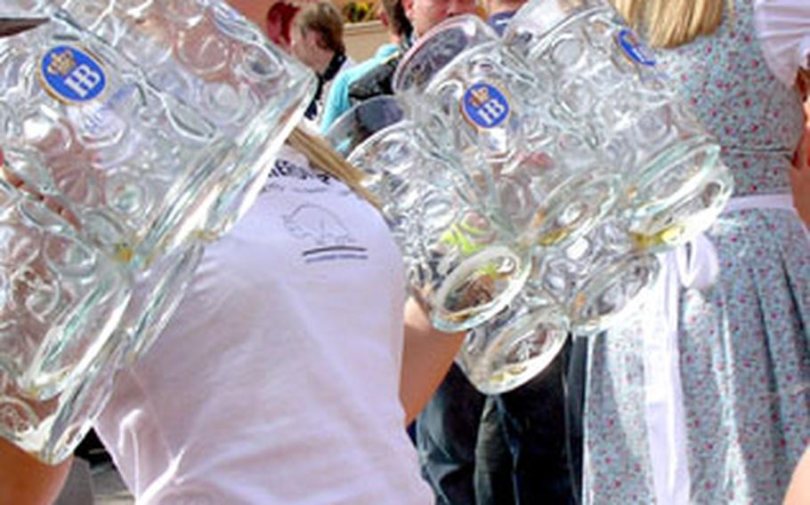 A reveler shows her beer handling skills outside the Hofbraü tent at this year's Oktoberfest in Munich, Germany, demonstrating that it's not too hard to hold a dozen mugs — when they're empty. More than 6 million people visit the world's most famous beer fest annually. This year's Oktoberfest ends Tuesday.