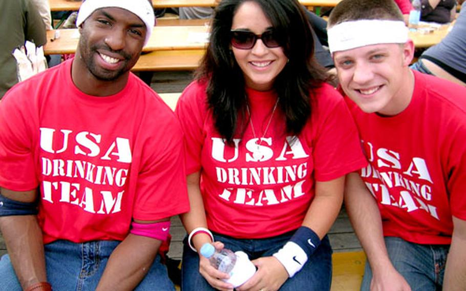 From left, Armstrong Expete, Veronica Norful and Jimmy Snyder wear special T-shirts on the opening day of Oktoberfest 2006. They were with a group of U.S. airmen from Geilenkirchen, Germany.