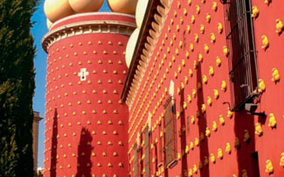 Part of the Theatre-Museu Dali in Figueres is painted red and topped with sculptures of eggs, a symbol of fertility. Inside the visual onslaught continues with huge paintings, drawings and sculptures by Salvador Dali.