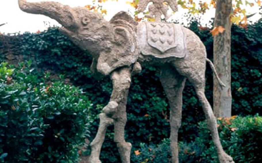 The Casa-Museu Castell Gala-Dali features a collection of Salvador Dali's fanciful sculptures among the bushes in front of the castle — including this spindly-legged elephant.