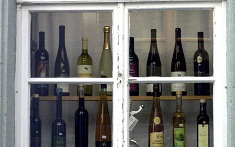 Locally produced wines are displayed in a store window in Neustadt an der Weinstrasse.