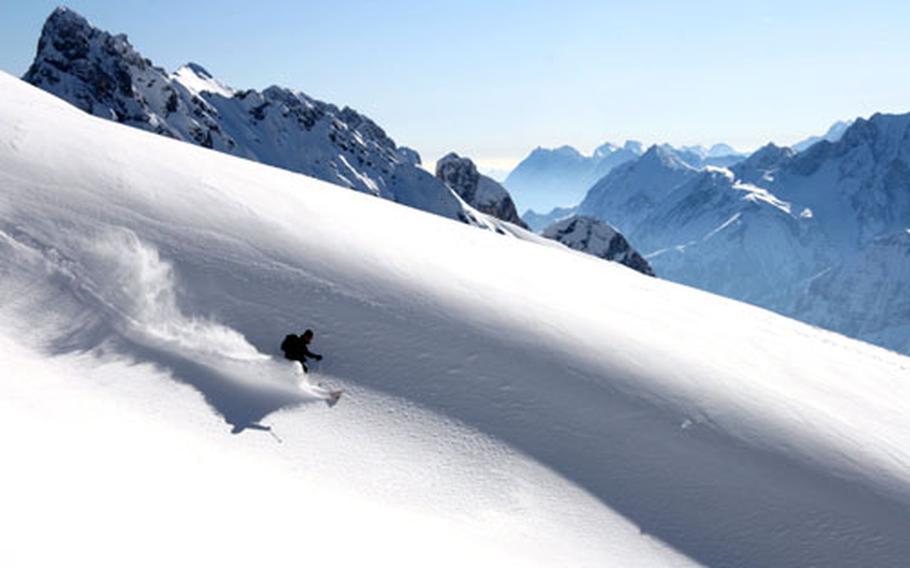 A skier glides through fresh powder on the Zugspitze during last winter's ski season.