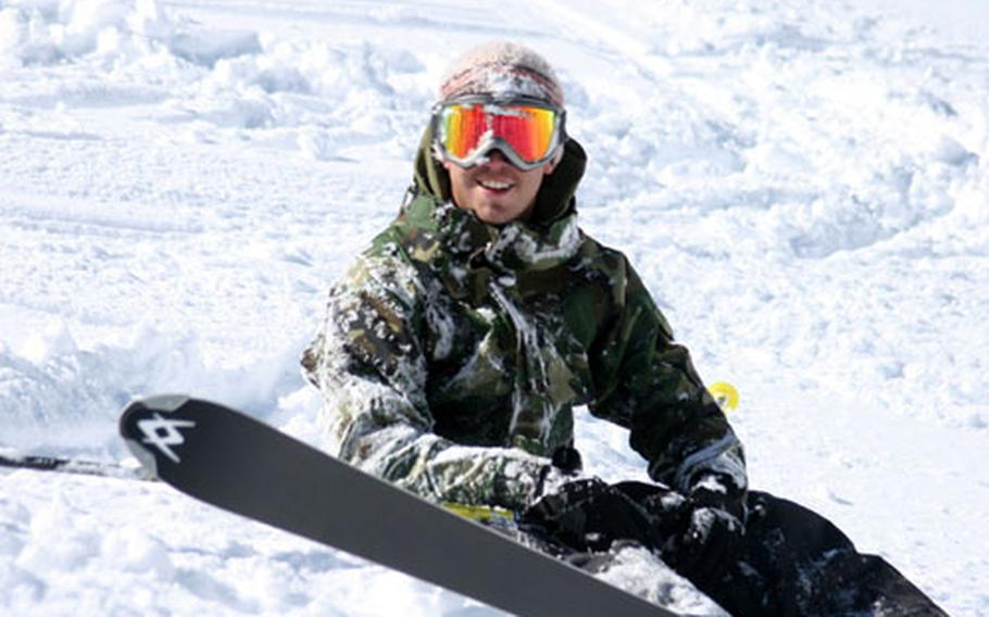 Ben Cannon, a visitor at Edelweiss Lodge and Resort in Garmisch, smiles after getting a face full of snow during a tumble on the Zugspitze during last winter's ski season.