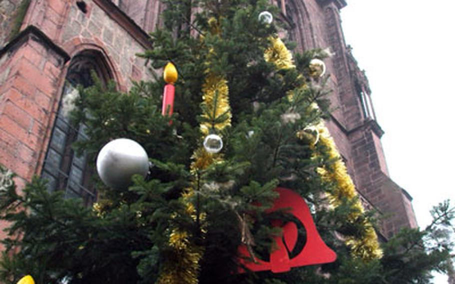 Eight differently decorated Christmas trees are displayed throughout the old town center of Sélestat, France. This one stands in front of St. George's Church.