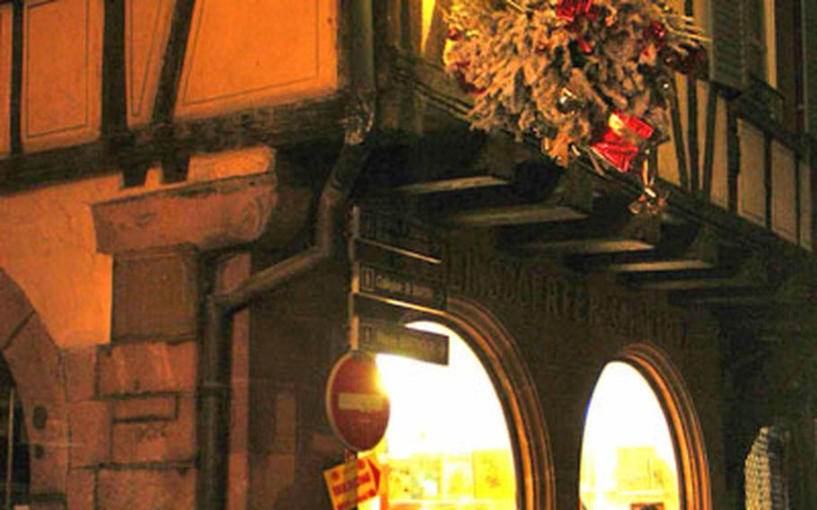 Even the shops are decorated with hanging Christmas trees in Sélestat.