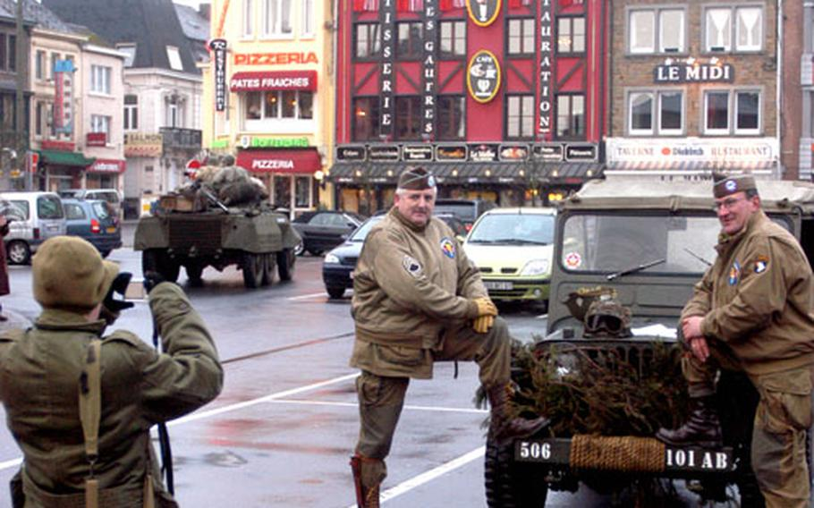 Even World War II re-enactors like to have their own pictures for keepsake. A group of Belgium re-enactors from Antwerp said their good-byes to McAuliffe Square the day after ceremonies marking the 62nd anniversary of the Battle of the Bulge ended. Behind them is a WWII troop carrier.