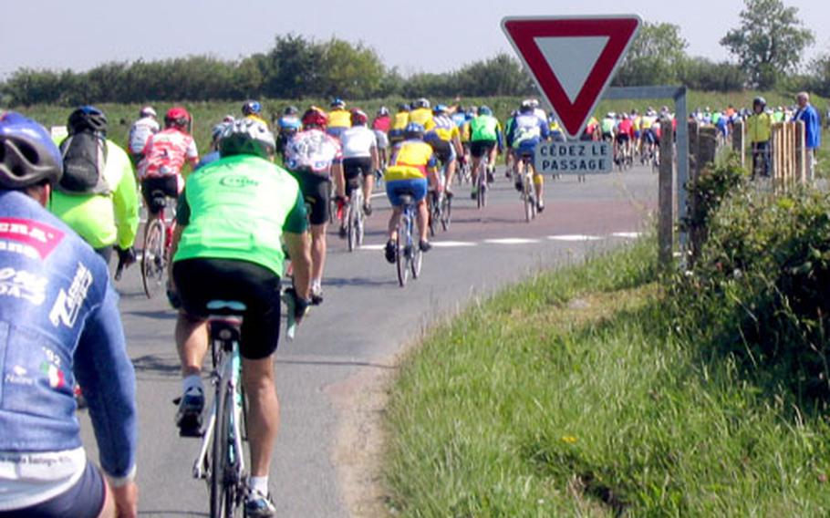 Cyclists round a bend in Normandy, France, during last year's Voie de la Liberté. More than 300 riders, including a contingent from U.S. military communities in Europe, participate in the annual tour.