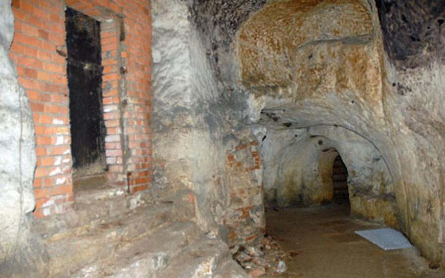 The modern brickwork on the left lies in stark contrast to the nearly 1,000-year-old chisel marks in the sandstone ceiling on the right in this small portion of the 7 1/2 miles of tunnels under the city of Bamberg.