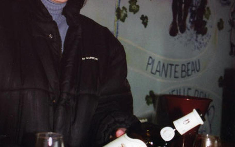 Sophie Vitali pours vin jaune (yellow wine) from the distinctive bottle, the clavelin, at the Jura winery, Domaine de la Pinte.