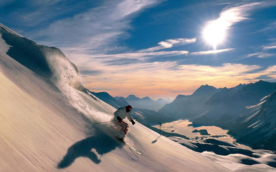 A skier's dream: Dramatic landscapes and fresh powder, such as this skier is enjoying in the Corvatsch area of Switzerland.