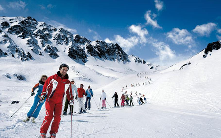An instructor leads a skiing class in Val Schlattain in Corviglia, above St. Moritz.