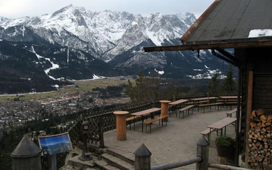 The patio at Saint Martin Hütte in Garmisch, Germany, offers good views of the village in the valley and some of the high peaks of the Bavarian Alps in the background.