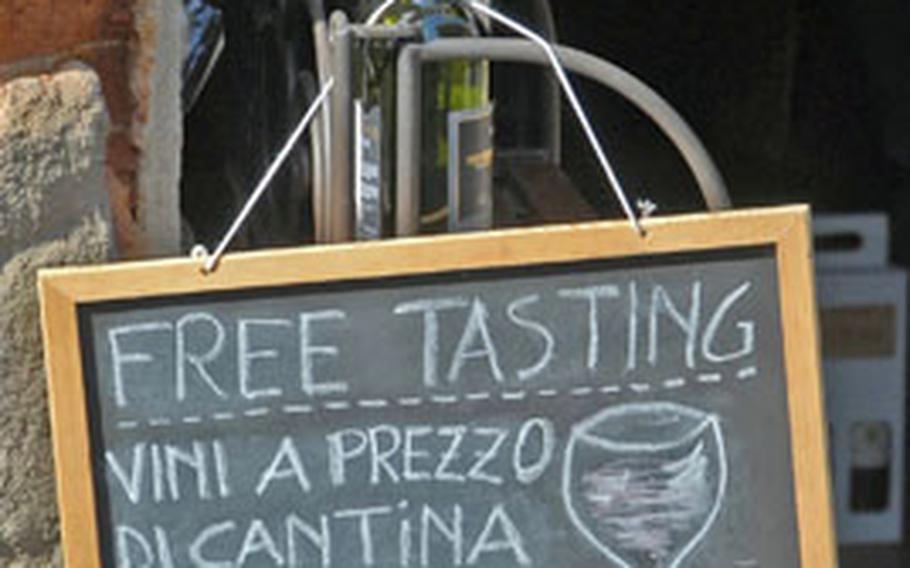 Signs like these are a familiar sight when traveling through the towns and vineyards of Tuscany.