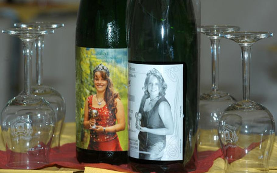 Both Julia Bitsch, left, the retiring wine queen, and Cora Kühn, 20, the new wine queen of Traben-Trabach, Germany, are honored on their own wine labels.