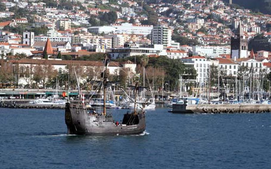 A replica of one of Christopher Columbus' ship, the Santa Maria, passes the capital city of Funchal on its daily trip to spot whales and dolphins.-