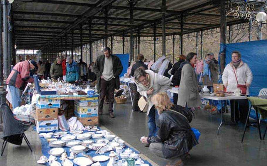 Visitors check out the goods at the Spa flea market. It takes place every Sunday morning in the Sept Heures park, behind the tourist office.