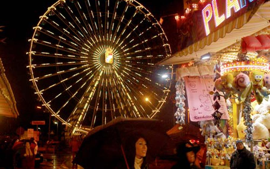 """The 150-foot-high """"Royal Bavarian Wheel"""" is one of the symbols of the Hochheimer Markt, a combination farmers market, county fair and carnival held near Wiesbaden, Germany."""