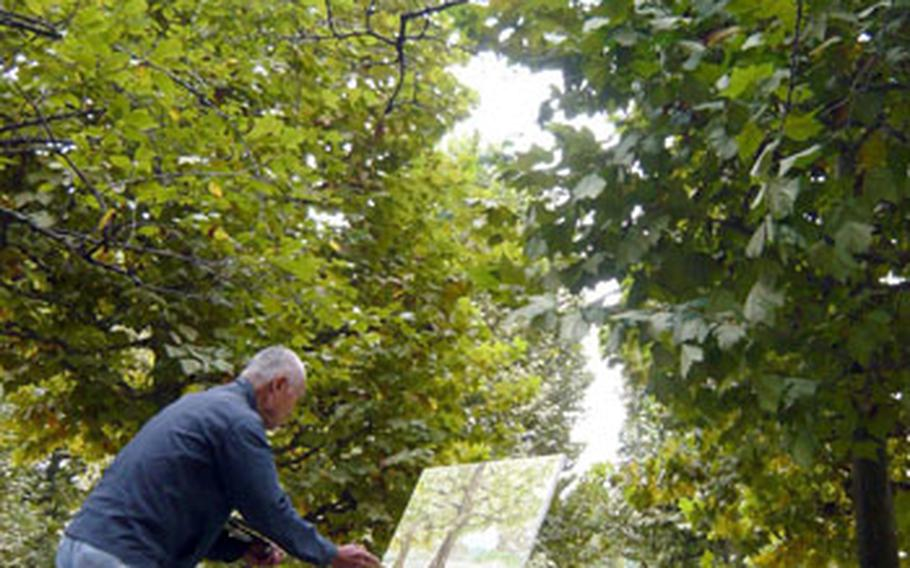 A man paints tulip trees planted at Shinjuku Gyoen National Garden. The trees are among 20,000 kinds of plants growing in the garden.