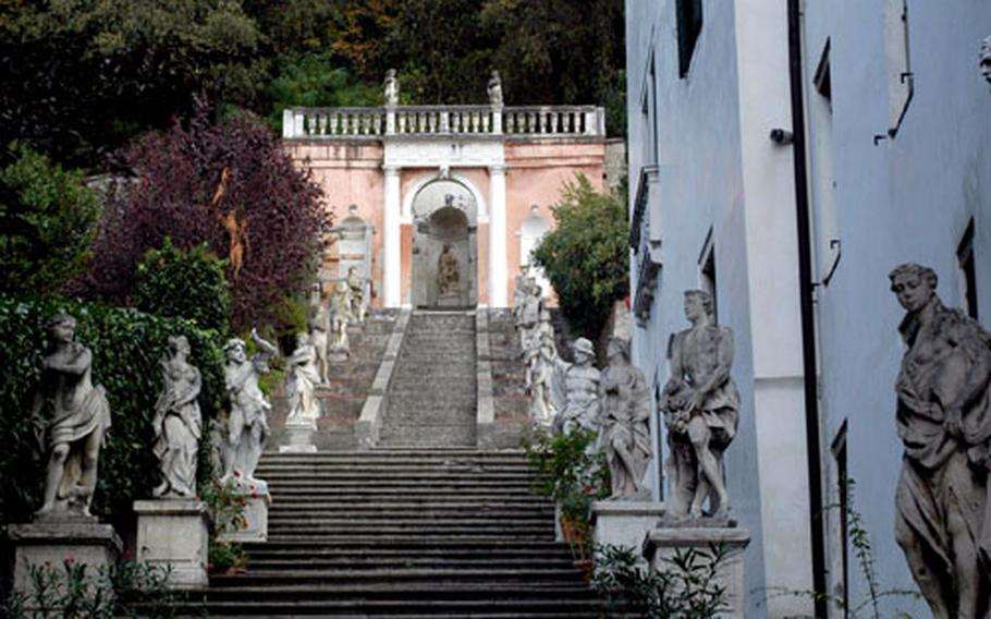Villa Noni-Mocenigo features an elaborate garden that can be seen through its gates. It's located along a cobblestone road that starts in the heart of the Monselice's medieval center and winds its way up the mountainside.