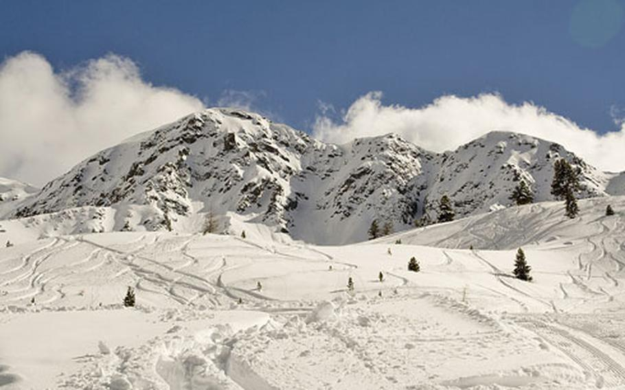 By the end of the day, the out-of-bounds area popular with experienced skiers shows the tracks of heavy use.