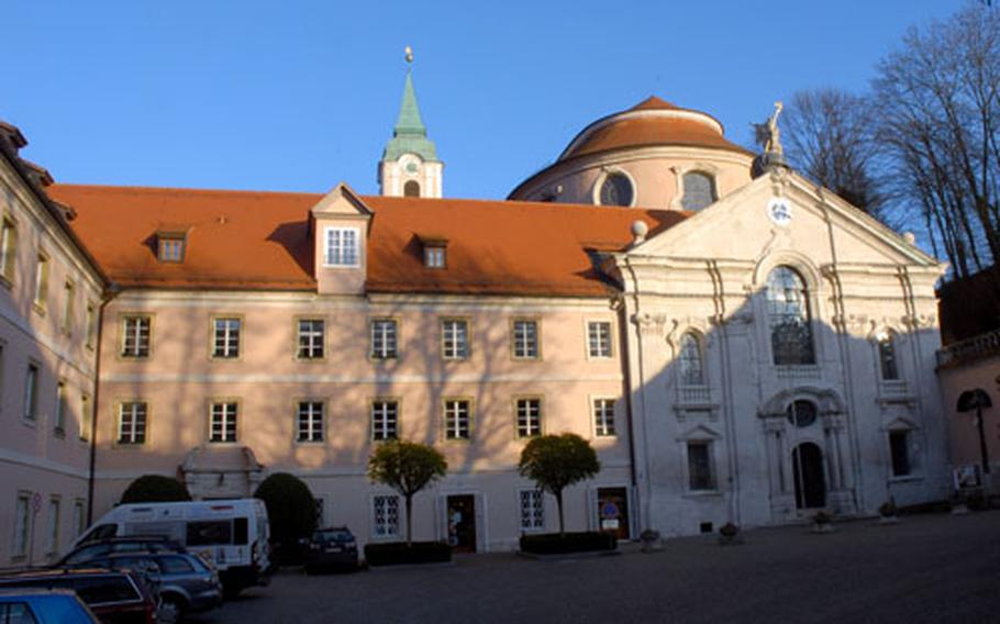 The courtyard of the Weltenburg Abbey gives litte hint of the baroque glories of the inside of the church, whose entrance is on the right. The abbey dates to the early seventh century, the church to the 18th.