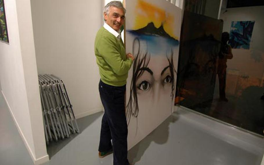 Entropy Art gallery manager Mauro Filomarino displays the work of graffiti artist Daze, on view until the end of November.