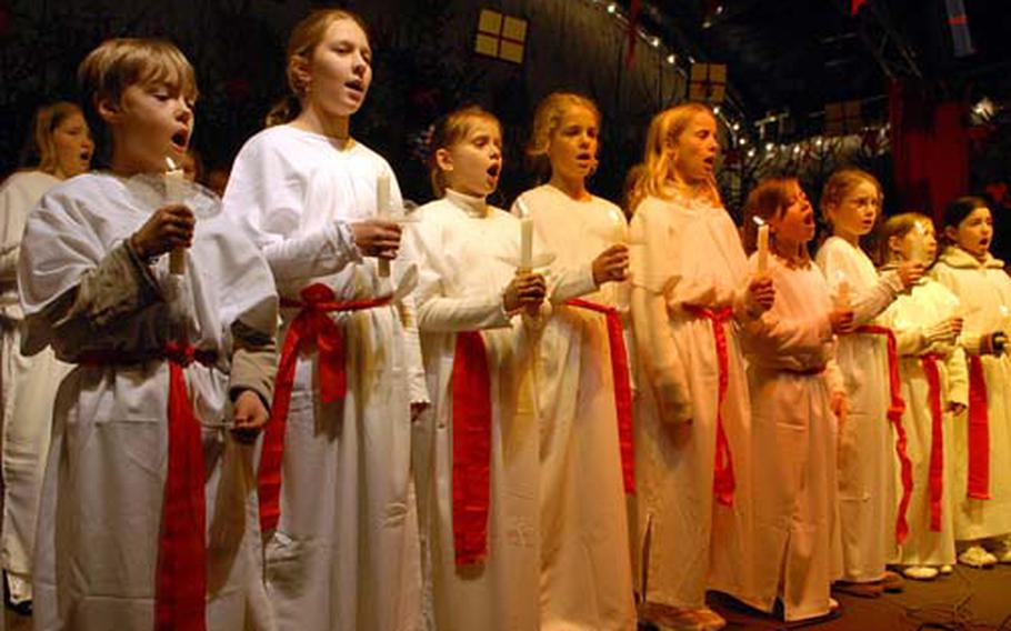 A children's choir entertains visitors at the Aachen, Germany, Christmas market.