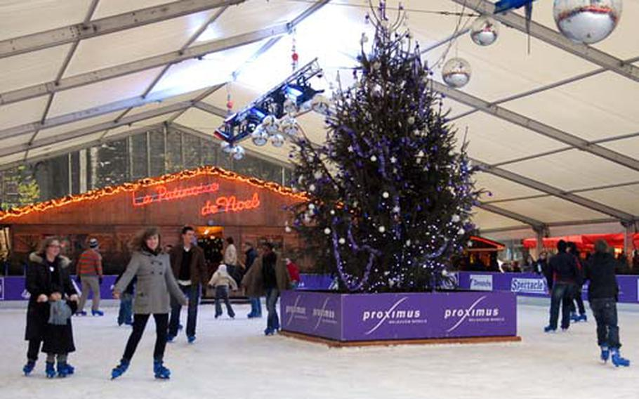 Skaters enjoy the ice rink set up on the cathedral square in Liège, Belgium.