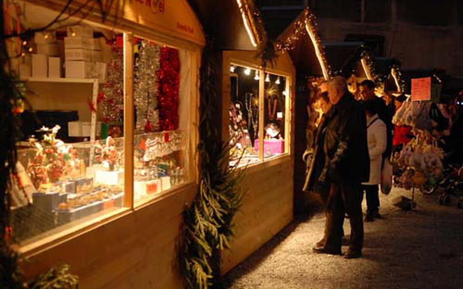 Visitors at the Christmas market in Liège, Belgium, shop for decorations and gifts.