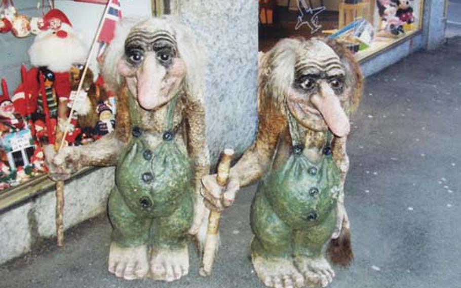 Most of Norway's trolls are said to move about only at night. But this pair guards a souvenir shop in downtown Oslo, not far from the city's Christmas market.