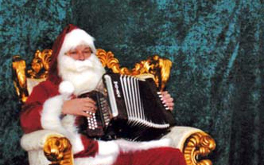 The Santa at Oslo's Christmas market provides musical entertainment when he's not conferring with the local children.
