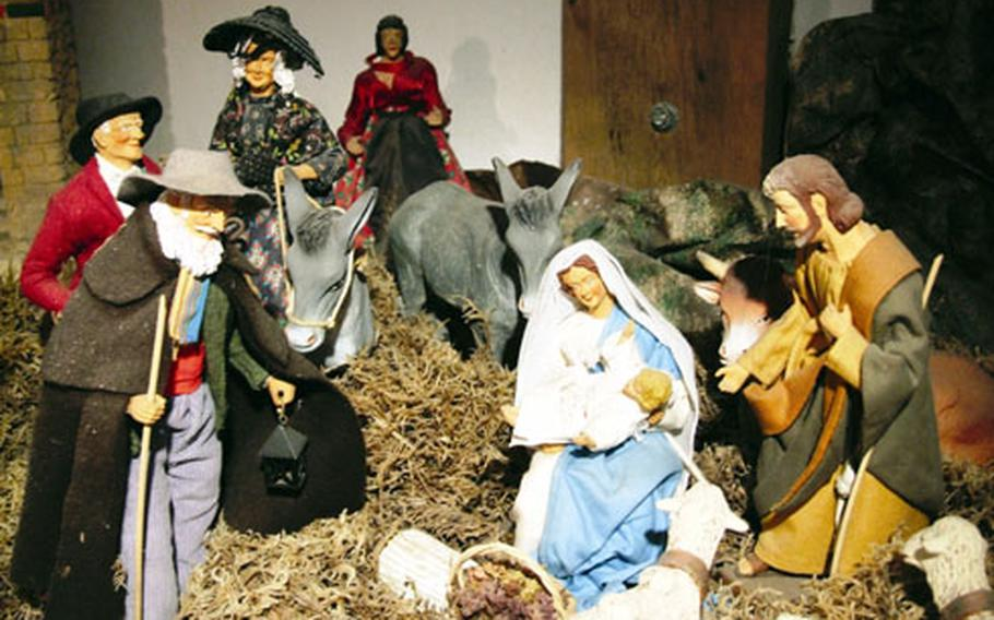 A nativity scene at the Santon Museum in Fontaine de Vaucluse, France, shows people dressed in Provençal style calling on Mary, Joseph and baby Jesus.