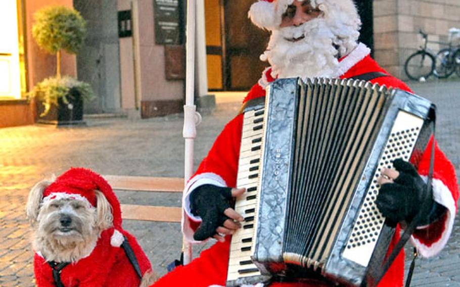 It seems Santa has made his list and checked it twice and has now taken up playing Christmas carols for passersby in downtown Nuremberg, Germany. It also appears he ditched Rudolph for a smaller four-legged friend.