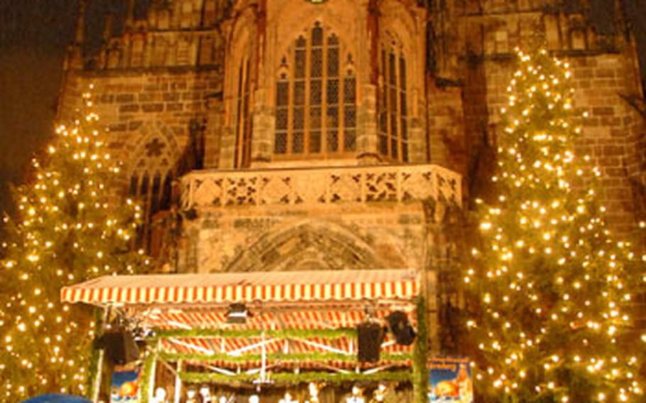 Visitors to the Nuremberg Christkindlesmarkt listen to a brass band play Christmas carols on a stage in front of the Frauenkirche on Hauptmarkt square. With 14 days to go to Christmas, market-goers braved cold, wet, snowy weather to shop for Christmas presents, drink hot mulled wine and enjoy the holiday spirit. The city's famed Christmas market lasts until Dec. 24.