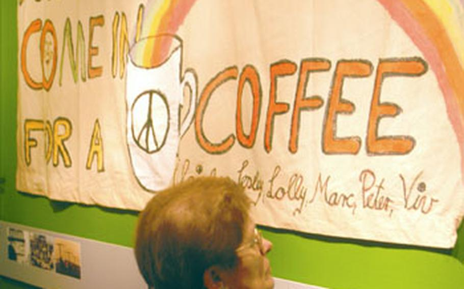 Visitors to an exhibit covering the U.S. military presence in the German state of Hessen pass through a series of stations, including one that mentions the German peace movement. The movement began in the late 1960s and continued, as this banner to peace indicates, through the Gulf War in 1991. This hand-painted sign hung from a building in downtown Fulda, which not long afterward saw U.S. soldiers depart for good.